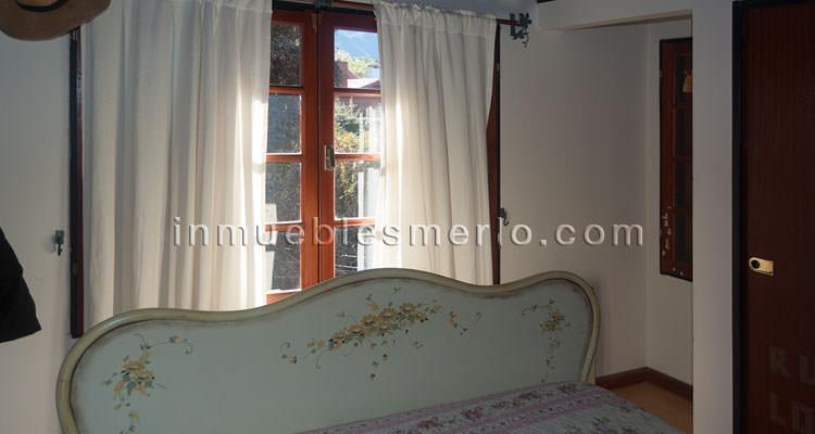 Dormitorio vista a sierras